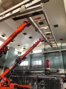 Two Jekko SPX 1275 cranes synchronising in a food factory